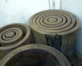 "Solid Black Walnut logs cut concentrically @ 1 1/2"" thick then kiln dried to 6-8% and ready to finish to tolerance."