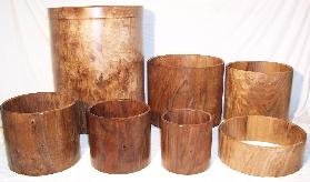 Set of 7 solid concentrically  lathed walnut cylinders for a drum kit