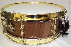 black walnut solid lathed snare with brass tube lugs and black on chrome trick throw-off