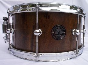Solid hallowed wood snare drum made from black walnut wood with ego double ended lugs