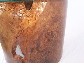 Close-up of swirly grain in this black walnut burl table with natural edges and inclusions.